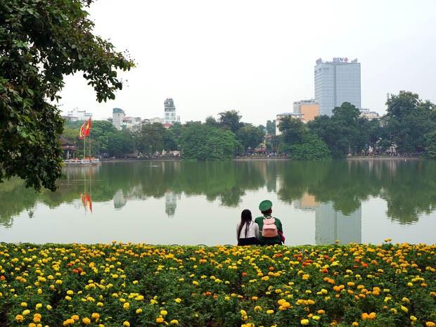 Locals At Hoan Kiem Lake Hanoi